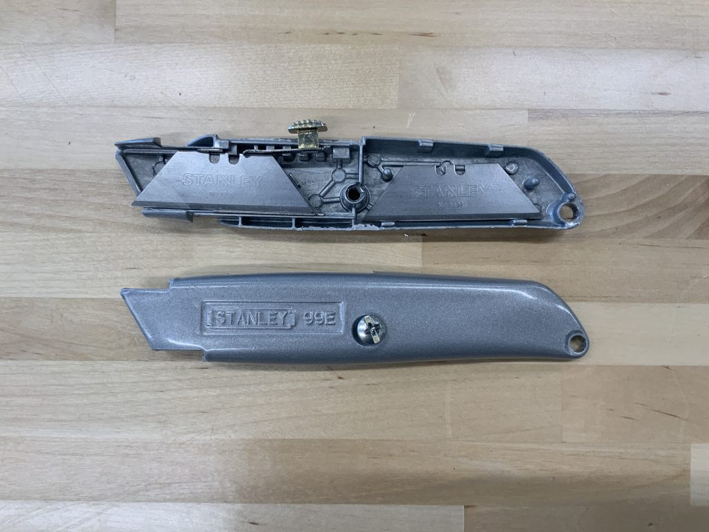 Disassembled utility knife